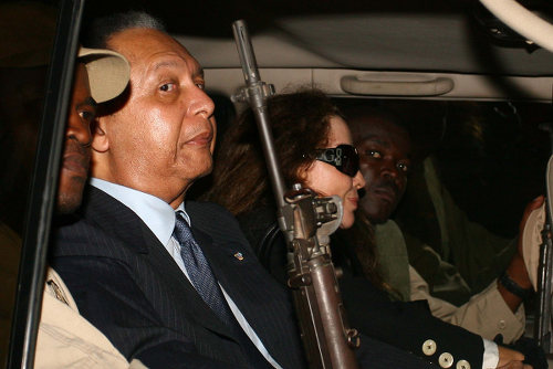 "Photo: Former Haiti president Jean-Claude ""Papa Doc"" Duvalier (second from left). (Copyright Tico Times)"