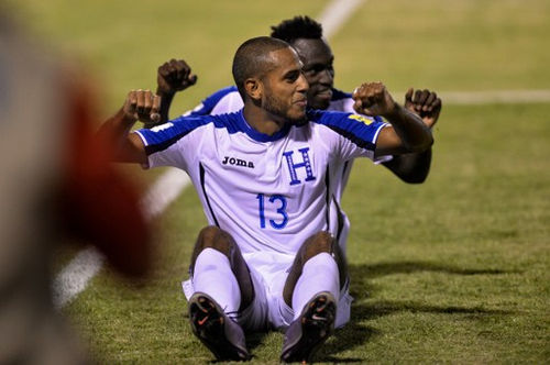 Photo: Honduras striker Eddie Hernandez (front) celebrates after scoring against Trinidad & Tobago during their 2018 FIFA World Cup qualifier football match in San Pedro Sula, Honduras on 15 November 2016. (Copyright AFP 2016/Gerardo Mazariegos)