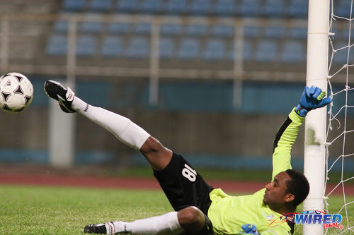 Photo: Police FC custodian Adrian Foncette improvises to make a save during Pro League against San Juan Jabloteh at the Ato Boldon Stadium on 1 November 2016. Jabloteh won 3-2. (Courtesy Chevaughn Christopher/Wired868)