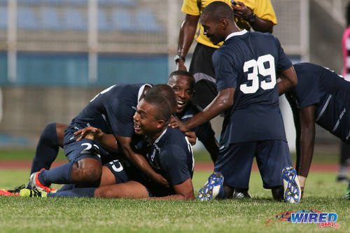 Photo: Police FC midfielder Kenaz Williams (centre) is mobbed by his teammates during Pro League action against W Connection at the Ato Boldon Stadium on 4 November 2016. (Courtesy Chevaughn Christopher/Wired868)