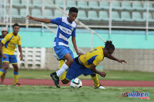 Photo: Presentation College winger Jordan Riley (centre) dribbles past Shiva Boys Hindu College player Shaquille Williams (right) during the South Zone Intercol final at the Mannie Ramjohn Stadium on 18 November 2016. (Courtesy Chevaughn Christopher/Wired868)