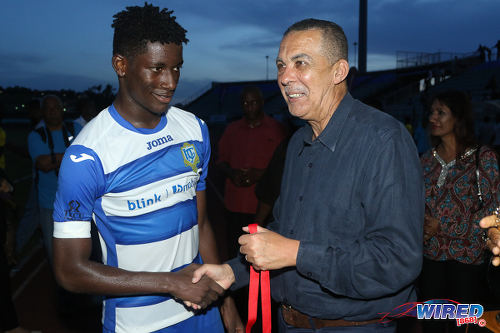 Photo: Presentation College (San Fernando) captain Kareem Riley (left) is congratulated by Trinidad and Tobago President and ex-Pres student Anthony Carmona after their school's 2-1 penalty shootout win over Shiva Boys Hindu College in the 2016 South Zone Intercol final at the Mannie Ramjohn Stadium on 18 November 2016. (Courtesy Chevaughn Christopher/Wired868)