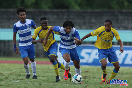 Photo: Presentation College attacker Nion Lammy (centre) charges at the Shiva Boys Hindu College defence during the South Zone Intercol final at the Mannie Ramjohn Stadium on 18 November 2016. (Courtesy Chevaughn Christopher/Wired868)