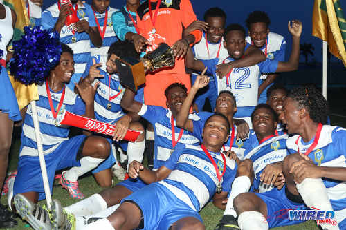 Photo: Presentation College (San Fernando) schoolboys celebrate with the 2016 South Zone Intercol trophy after defeating Shiva Boys Hindu College 2-1 in kicks from the penalty mark at the Mannie Ramjohn Stadium on 18 November 2016. (Courtesy Chevaughn Christopher/Wired868)