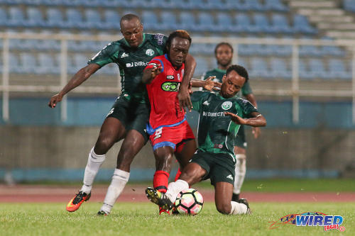 Photo: St Ann's Rangers midfielder Jameel Antoine (centre) is harassed by W Connection players Daneil Cyrus (left) and Kevon Goddard during Pro League action at the Ato Boldon Stadium on 4 November 2016. (Courtesy Chevaughn Christopher/Wired868)