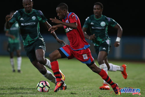 Photo: St Ann's Rangers attacker Jomoul Francois (centre) runs at the W Connection defence during Pro League action at the Ato Boldon Stadium on 4 November 2016. (Courtesy Chevaughn Christopher/Wired868)