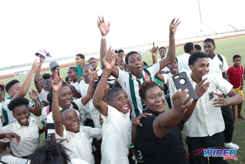 Photo: San Juan North Secondary fans try to capture the moment as they celebrate their East Zone Intercol final triumph over St Augustine Secondary at the Larry Gomes Stadium, Malabar on 21 November 2016. (Courtesy Annalicia Caruth/Wired868)