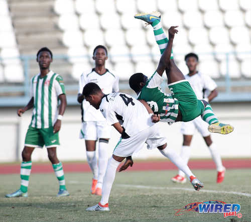 Photo: San Juan North Secondary striker Renaldo Boyce (right) attempts a bicycle kick during the East Zone Intercol final against St Augustine Secondary at the Larry Gomes Stadium, Malabar on 21 November 2016. (Courtesy Annalicia Caruth/Wired868)