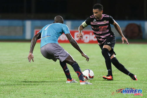 Photo: Ma Pau Stars right back Carlos Edwards (right) takes on Morvant Caledonia United attacker Kordell Samuel during Pro League at the Ato Boldon Stadium in Couva on 22 November 2016. (Courtesy Sean Morrison/Wired868)