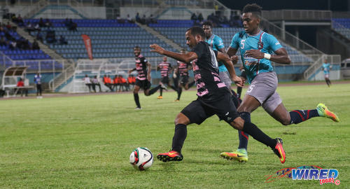Photo: Ma Pau Stars winger Hayden Tinto (left) takes on Morvant Caledonia United defender Seon Thomas during Pro League at the Ato Boldon Stadium in Couva on 22 November 2016. (Courtesy Sean Morrison/Wired868)