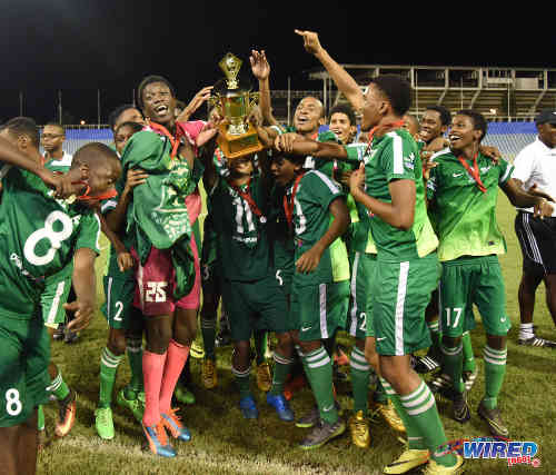 Photo: Trinity College (Moka) players celebrate with the 2016 North Zone Intercol trophy after edging St Anthony's College on kicks from the penalty at the Hasely Crawford Stadium in Port of Spain. (Courtesy Wired868)