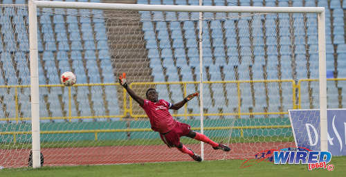 Photo: Trinity College Moka goalkeeper Desean Bowen stretches in vain for the ball during a penalty shootout against St Mary's College at the North Zone Intercol semifinal at the Hasely Crawford Stadium on 16 November 2016. Bowen made a crucial block as Trinity Moka advanced to the North Zone final. (Copyright Sean Morrison/Wired868)