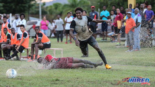 Photo: Trinity College East attacker Dwight Yorke (right) leaves a Malick Secondary opponent for dead during Championship Big 5 Play Off action in Trincity on 6 November 2016. (Courtesy Sean Morrison/Wired868)