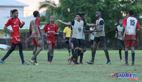 Photo: Trinity College East attacker Kishon Hackshaw (centre) acts as peacemaker while teammate Nickel Orr (second from right) and Malick Secondary captain Brandon Charles (second from left) exchange unpleasantries during Championship Big 5 Play Off action in Trincity on 6 November 2016. Looking on (third from left) is Malick maestro Shaquille Mayers. (Courtesy Sean Morrison/Wired868)