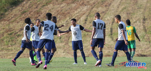 Photo: Trinity College East midfielder Kishon Hackshaw (centre) accepts the congratulations of his teammates during SSFL Championship Big 5 PlayOff action away to Princes Town West Secondary on 4 November 2016. (Courtesy Sean Morrison/Wired868)