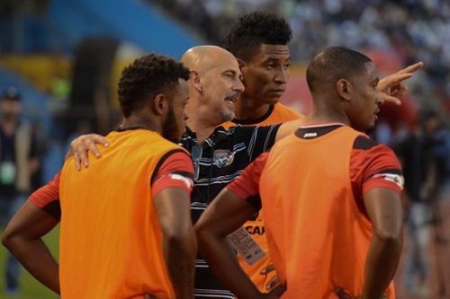 Photo: Trinidad and Tobago coach Stephen Hart (centre) gives instructions to substitutes (from right) Andre Boucaud, Willis Plaza and Jomal Williams during their 2018 FIFA World Cup qualifier against Honduras in San Pedro Sula, Honduras on 15 November 2016. (Copyright AFP 2016/Orlando Sierra)