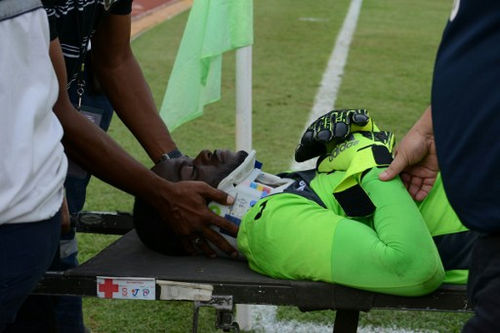 Photo: Trinidad and Tobago goalkeeper Jan-Michael Williams is taken out of the field on a stretcher during their 2018 FIFA World Cup qualifier in San Pedro Sula, Honduras on 15 November 2016. (Copyright AFP 2016/Orlando Sierra)