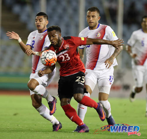 Photo: Trinidad and Tobago midfielder Jomal Williams (centre) tries hold off Costa Rica defenders Johnny Acosta (left) and Francisco Calvo during Russia 2018 World Cup qualifying action against Costa Rica at the Hasely Crawford Stadium on 11 November 2016. (Courtesy Allan V Crane/Wired868)