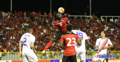 Photo: Trinidad and Tobago captain Kenwyne Jones (top) climbs to head the ball during Russia 2018 World Cup qualifying action against Costa Rica at the Hasely Crawford Stadium on 11 November 2016. (Courtesy Sean Morrison/Wired868)