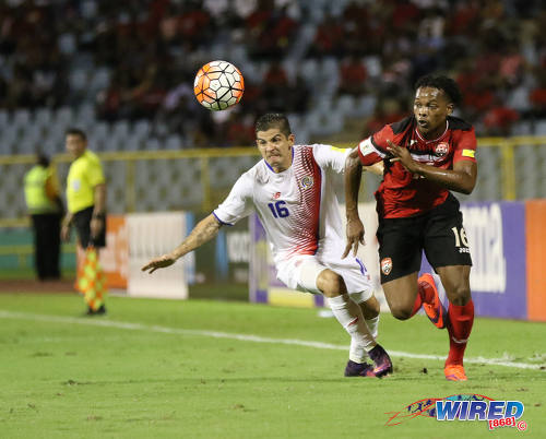 Photo: Trinidad and Tobago winger Levi Garcia (right) dashes past Costa Rica right wing back Christian Gamboa during Russia 2018 World Cup qualifying action at the Hasely Crawford Stadium on 11 November 2016. (Courtesy Sean Morrison/Wired868)