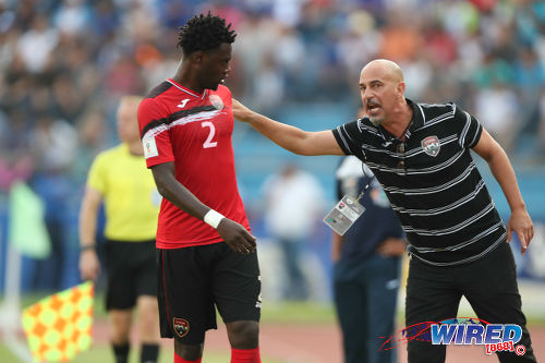 Photo: Trinidad and Tobago coach Stephen Hart (right) passes on instructions to left back Aubrey David during 2018 World Cup qualifying action against Honduras in San Pedro Sula on 15 November 2016. (Courtesy Allan V Crane/Wired868)