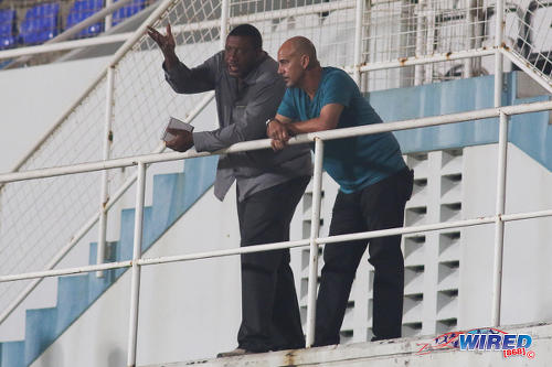 Photo: Trinidad and Tobago Football Association (TTFA) president and W Connection owner David John-Williams (left) has a word with Soca Warriors coach Stephen Hart during Pro League action at the Ato Boldon Stadium on 4 November 2016. (Courtesy Chevaughn Christopher/Wired868)