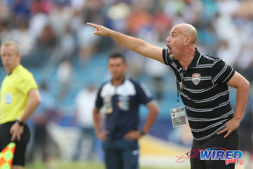 Photo: Trinidad and Tobago National Senior Team coach Stephen Hart (right) shouts instructions during 2018 World Cup qualifying action against Honduras in San Pedro Sula on 15 November 2016. (Courtesy Allan V Crane/CA-Images/Wired868)