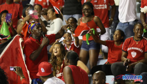 Photo: Trinidad and Tobago soca legend Superblue (left) serenades Soca Warriors fans during Russia 2018 World Cup qualifying action against Costa Rica at the Hasely Crawford Stadium on 11 November 2016. (Courtesy Sean Morrison/Wired868)