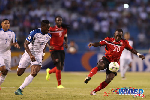Photo: Trinidad and Tobago forward Trevin Caesar (right) tries to escape the attentions of Honduras defender Maynor Figueroa during 2018 World Cup qualifying action in San Pedro Sula on 15 November 2016. (Courtesy Allan V Crane/Wired868)