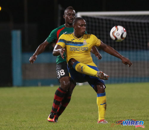 Photo: Defence Force striker Devorn Jorsling (right) cushions the ball while San Juan Jabloteh defender Jevon Morris stands guard during Pro League action at the Ato Boldon Stadium on 18 September 2016. (Courtesy Sean Morrison/Wired868)