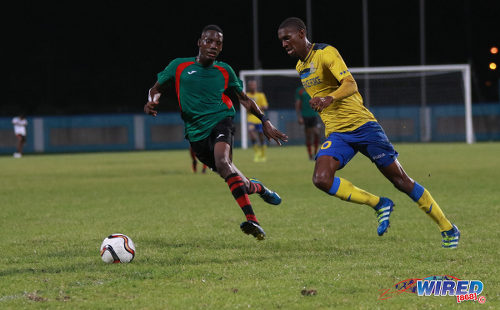 Photo: Defence Force playmaker Hashim Arcia (right) attempts to glide past San Juan Jabloteh defender Jerome Isaiah McIntyre during Pro League action at the Ato Boldon Stadium on 18 September 2016. (Courtesy Sean Morrison/Wired868)