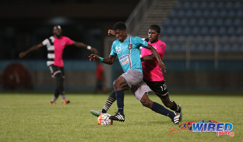 Photo: Morvant Caledonia United flanker Jameel Neptune (left) tries to evade Central FC midfielder Kishun Seecharan during Pro League action at the Ato Boldon Stadium in Couva on 20 December 2016. (Courtesy Chevaughn Christopher/Wired868)