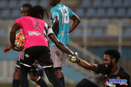 Photo: Central FC attacker Jason Marcano (left) offers Morvant Caledonia United goalkeeper Stephon Seepersad a hand during Pro League action at the Ato Boldon Stadium in Couva on 20 December 2016. (Courtesy Chevaughn Christopher/Wired868)