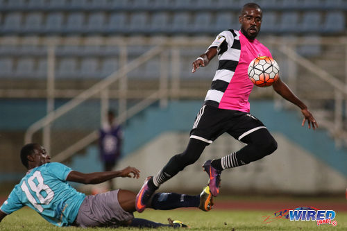 Photo: Central FC substitute Johan Peltier (right) shrugs off a challenge from Morvant Caledonia United defender Maestro Mensah en route to scoring his team's opener during Pro League action at the Ato Boldon Stadium in Couva on 20 December 2016. (Courtesy Chevaughn Christopher/Wired868)