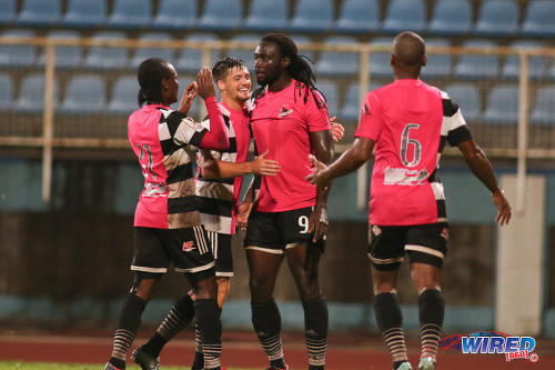 Photo: Central FC forward Kenwyne Jones (second from right) is congratulated by midfielder Sean De Silva (second from left) after his decisive goal against W Connection during Pro League action at the Ato Boldon Stadium in Couva on 12 December 2016. (Courtesy Chevaughn Christopher/Wired868)