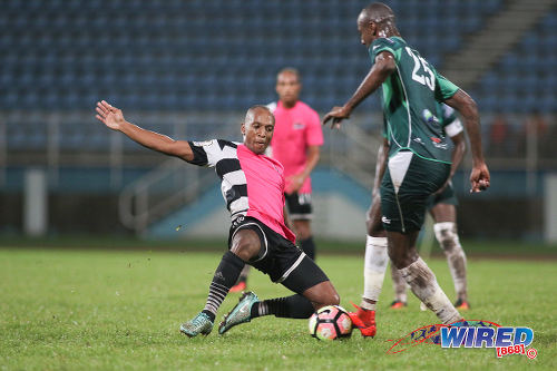 Photo: Central FC midfielder Leston Paul (left) flies into a tackle against W Connection defender Daneil Cyrus during Pro League action at the Ato Boldon Stadium in Couva on 12 December 2016. (Courtesy Chevaughn Christopher/Wired868)