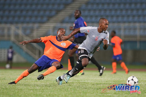 Photo: Central FC midfielder Leston Paul (right) looks to escape from a Club Sando opponent during Pro League action at the Ato Boldon Stadium on 16 December 2016. (Courtesy Chevaughn Christopher/Wired868)