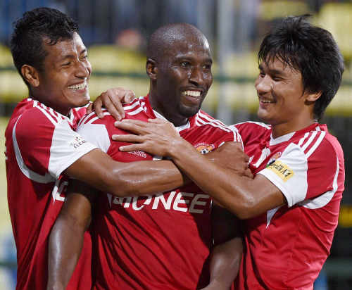 Photo: Trinidad and Tobago international striker Cornell Glen (centre) celebrates with teammates during his spell with I-League team, Shillong Lajong FC. (Copyright DNA India)