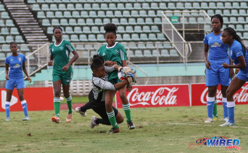 Photo: The Fyzabad Secondary goalkeeper tries to repel an attack from St Augustine Secondary player Jahmealia Jackson during the 2016 Girls National Intercol final at the Mannie Ramjohn Stadium in Marabella on 2 December 2016. (Courtesy Sean Morrison/Wired868)