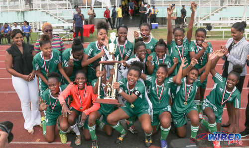 Photo: The St Augustine Secondary girls team celebrate with the 2016 National Intercol trophy after defeating Fyzabad Secondary at the Mannie Ramjohn Stadium in Marabella on 6 December 2016. (Courtesy Sean Morrison/Wired868)