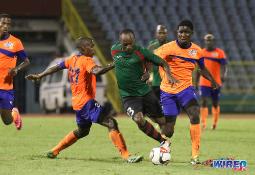 Photo: San Juan Jabloteh attacker Kennedy Hinkson (centre) tries to weave between two Club Sando players during Pro League action at the Hasely Crawford Stadium on 9 December 2016. (Courtesy Sean Morrison/Wired868)