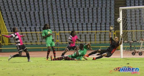 Photo: San Juan Jabloteh goalkeeper Shem Louison (far right) tries in vain to keep out an attempt at goal by Central FC captain Darren Mitchell (far left) during Pro League action at the Hasely Crawford Stadium on 2 December 2016. (Courtesy Sean Morrison/Wired868)