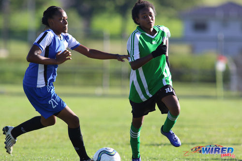 Photo: Penal Secondary attacker Alexcia Ali (right) tries to evade a Fyzabad Anglican Secondary opponent during the Girls South Zone Knockout final at the Mannie Ramjohn Stadium training ground on 2 December 2016. (Courtesy Chevaughn Christopher/Wired868)
