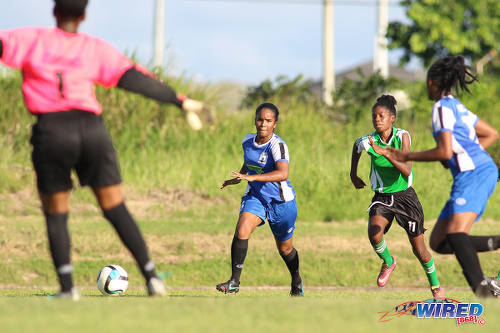 Photo: Penal Secondary attacker Kayla Garcia (second from right) tries to get past the Fyzabad Anglican Secondary defence during the Girls South Zone Knockout final at the Mannie Ramjohn Stadium training ground on 2 December 2016. (Courtesy Chevaughn Christopher/Wired868)