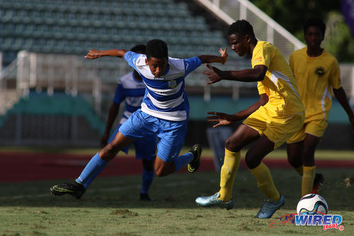 Photo: Presentation College (San Fernando) winger Jordan Riley eludes a Signal Hill Secondary opponent during the National Intercol Semifinals at the Mannie Ramjohn Stadium on 3 December 2016. (Courtesy Chevaughn Christopher/Wired868)