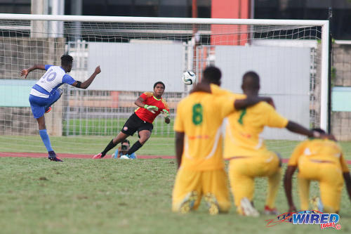 Photo: Presentation College (San Fernando) captain Kareem Riley (left) places his penalty past Signal Hill Secondary goalkeeper Njeri Fermin during the National Intercol Semifinals at the Mannie Ramjohn Stadium on 3 December 2016. Presentation won 5-3 on kicks from the penalty mark to advance to the National Intercol finals. (Courtesy Chevaughn Christopher/Wired868)