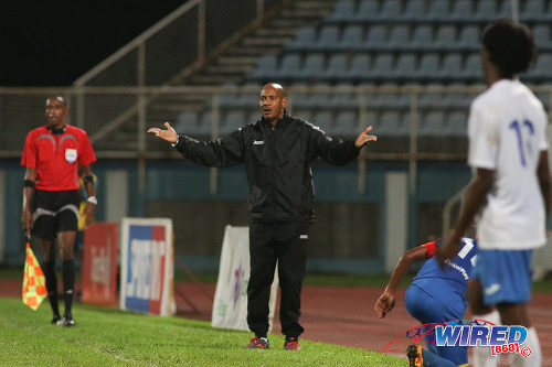 Photo: Presentation College (San Fernando) coach Shawn Cooper (centre) gestures from the sidelines during their SSFL Big Four semifinal contest against Shiva Boys Hindu College on 9 December 2016 at the Ato Boldon Stadium in Couva. (Courtesy Chevaughn Christopher/Wired868)