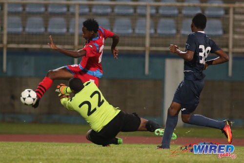 Photo: St Ann's Rangers substitute Kathon St Hillaire (left) tries to find a way around Police FC goalkeeper Theon Browne during Pro League action at the Ato Boldon Stadium in Couva on 20 December 2016. (Courtesy Chevaughn Christopher/Wired868)