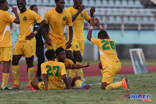 Photo: Signal Hill Secondary goal scorer Ronaldo Samuel (far right) celebrates with his teammates during National Intercol Semifinal action against Presentation College (San Fernando) at the Mannie Ramjohn Stadium on 3 December 2016. (Courtesy Chevaughn Christopher/Wired868)
