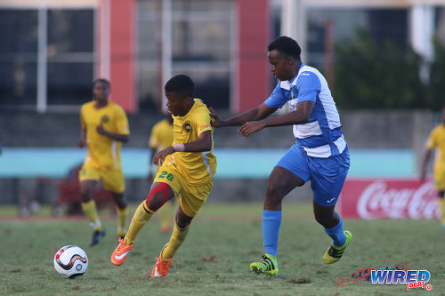 Photo: Signal Hill Secondary forward Ronaldo Samuel (left) takes on Presentation College (San Fernando) defender Matthew Joseph during the National Intercol Semifinals at the Mannie Ramjohn Stadium on 3 December 2016. (Courtesy Chevaughn Christopher/Wired868)